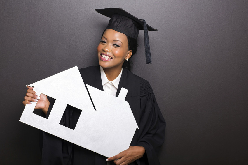 attractive african female university graduate holding white paper house