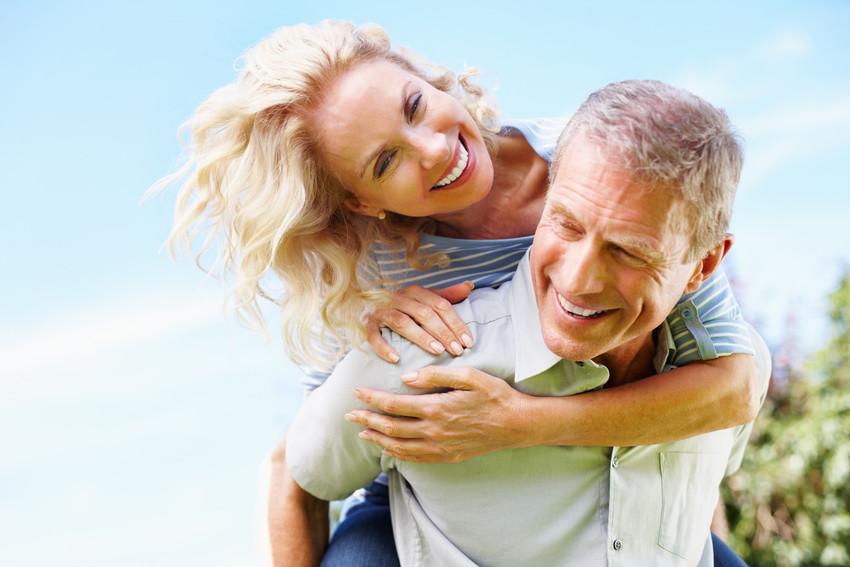 happy fun-loving active adult couple