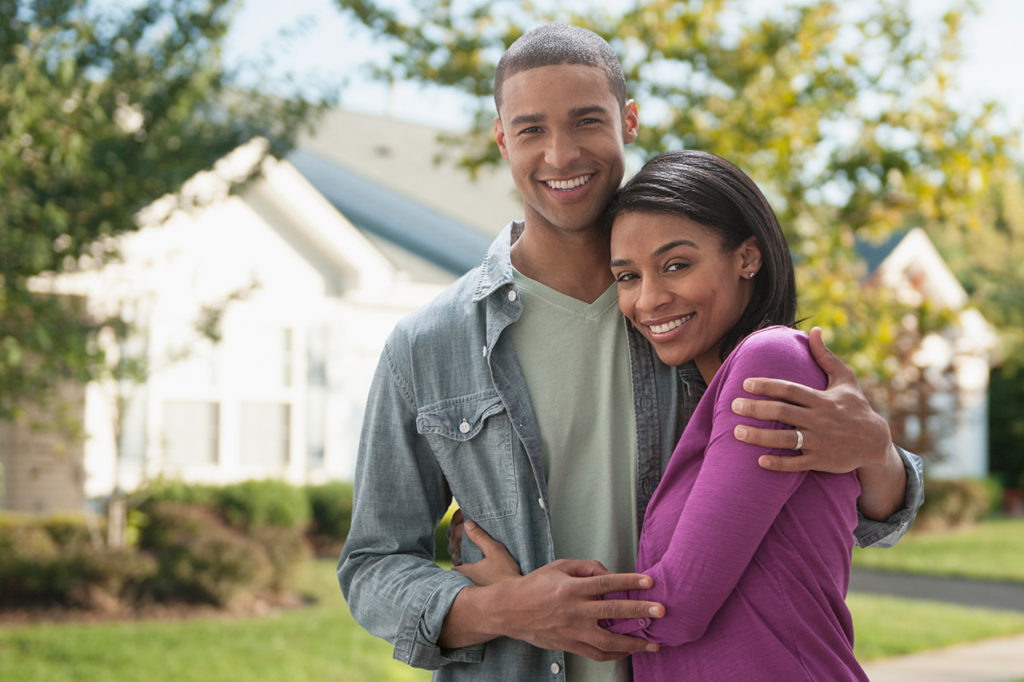 happy home buyers finding their first home