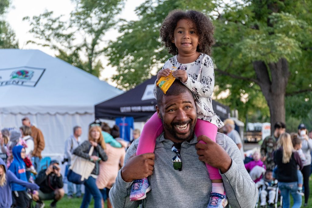 a father and daughter at an event